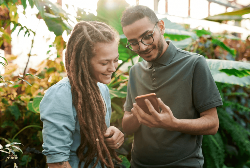 Man and woman looking at mobile phone